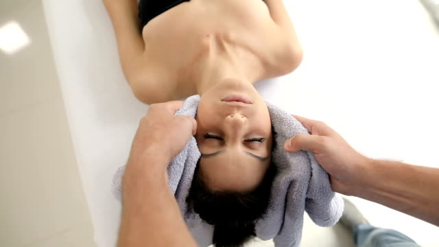 beautiful young woman in spa salon getting massage - spa treatment stock videos & royalty-free footage