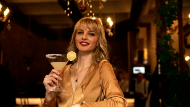 beautiful young woman in the bar - cocktail stock videos & royalty-free footage