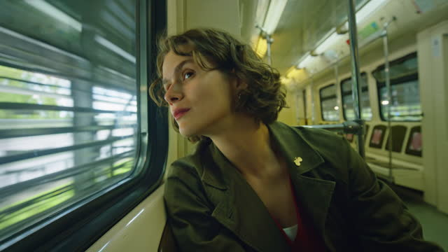 beautiful young woman in train or subway car - nur junge frauen stock-videos und b-roll-filmmaterial