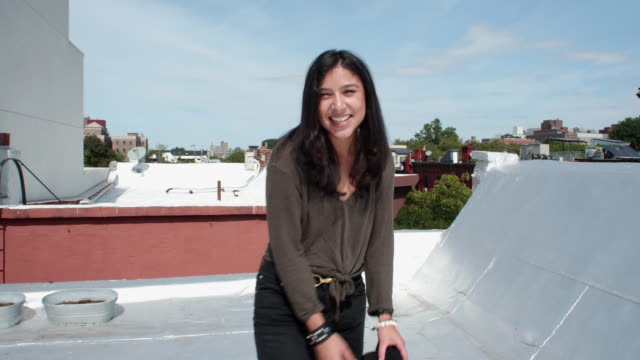 cu beautiful young woman laughs at camera on city rooftop - nose piercing stock videos & royalty-free footage