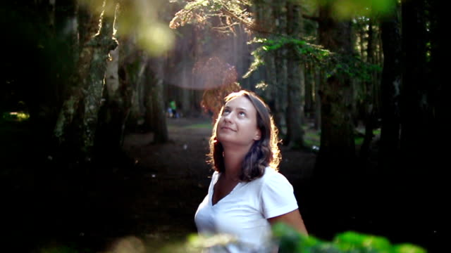 beautiful young woman looking up in a forest - waist up stock videos & royalty-free footage