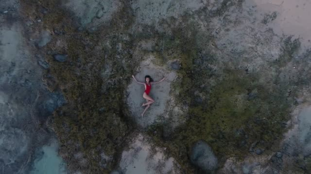 beautiful young woman lying in the sand at the beach bali - sdraiato video stock e b–roll