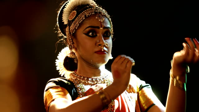 cu beautiful young woman making bharatanatyam gesture / india - popolazione del subcontinente indiano video stock e b–roll