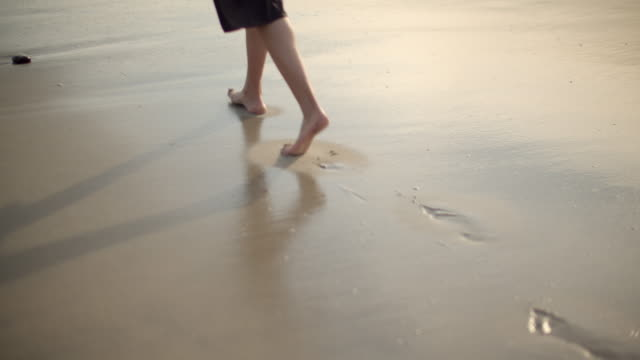cu beautiful young woman on the beach - sabbia video stock e b–roll
