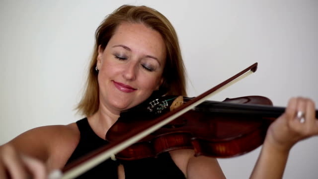 beautiful young woman playing violin. - violinist stock videos & royalty-free footage