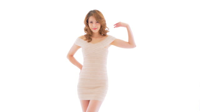 ms beautiful young woman posing against white background, bejing - three quarter length stock videos & royalty-free footage