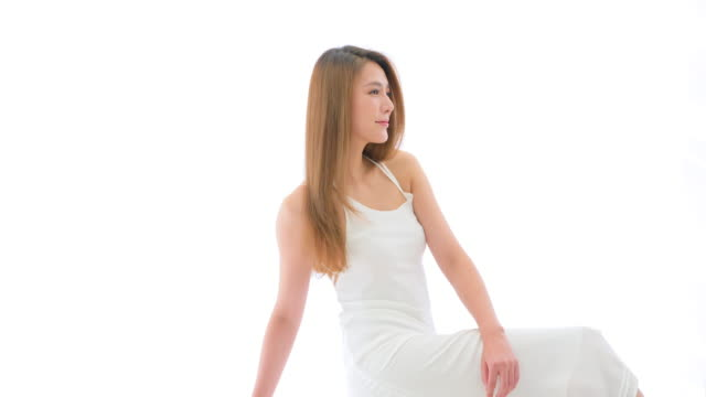 ms beautiful young woman posing against white background - straight hair stock videos & royalty-free footage