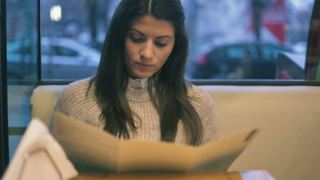 beautiful young woman reading the menu. - menu stock videos & royalty-free footage