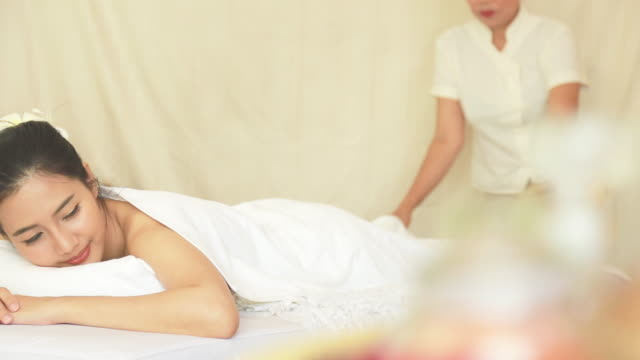 beautiful young woman receiving massage and spa - spa treatment stock videos & royalty-free footage