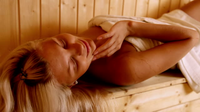 beautiful young woman relaxing in sauna - sauna stock videos & royalty-free footage