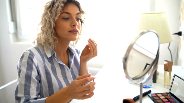 beautiful young woman removing makeup - viso naturale video stock e b–roll