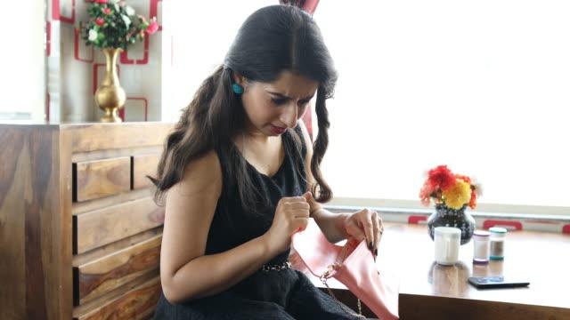 beautiful young woman searching - handbag stock videos & royalty-free footage