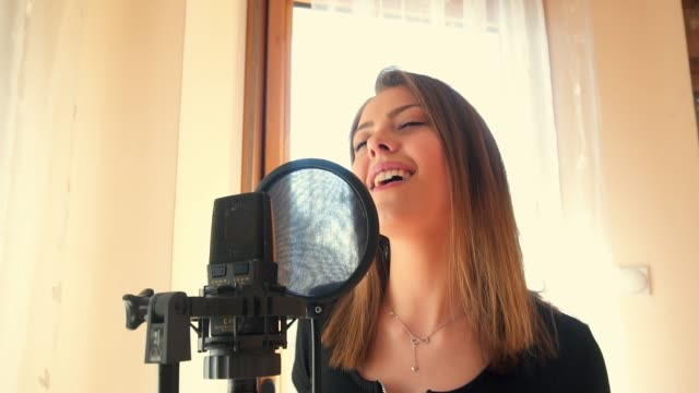 beautiful young woman singing - solo performance stock videos and b-roll footage