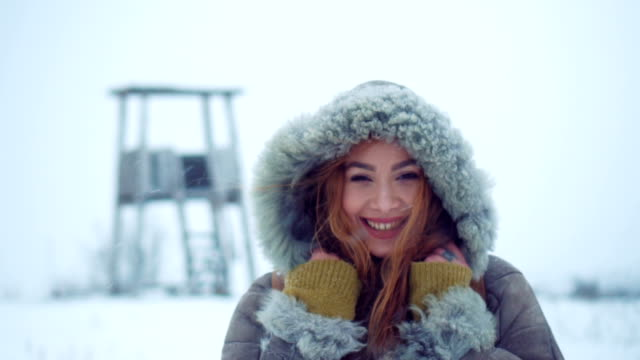 Beautiful young woman smiling in winter day