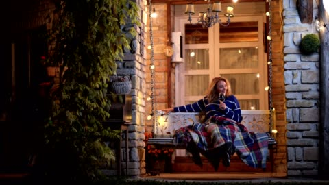 beautiful young woman swinging on a porch swing - porch stock videos & royalty-free footage