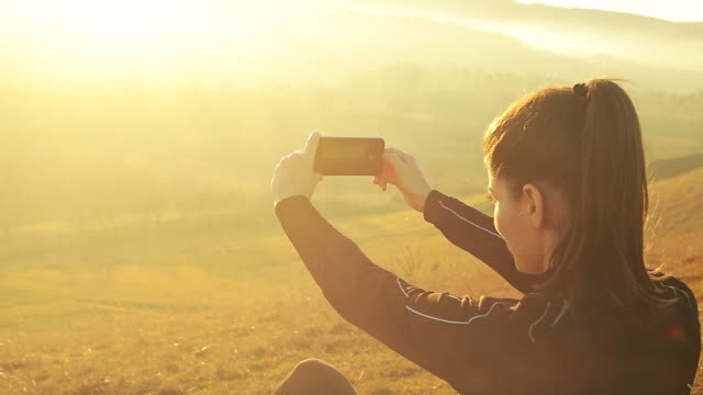 beautiful young woman taking photos in nature. - filming stock videos and b-roll footage