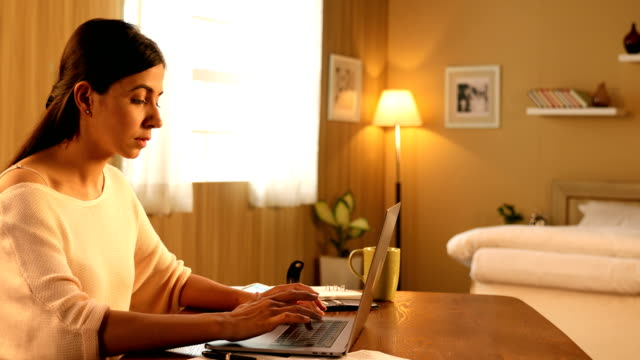 """MS Beautiful young woman using laptop at home / New Delhi, Delhi, India """