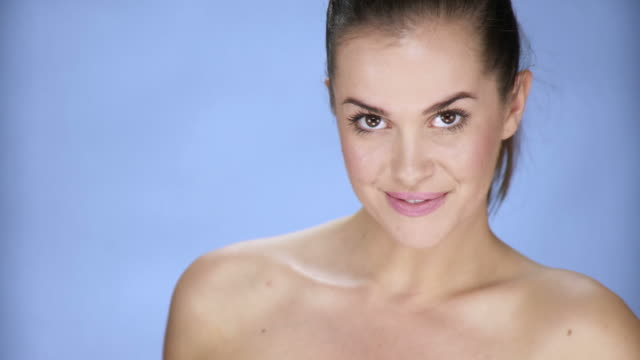 hd: beautiful young woman - light blue stock videos & royalty-free footage