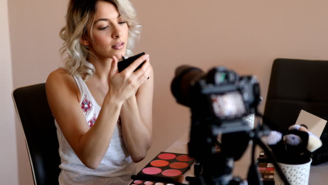 beautiful young woman vlogging about cosmetics - tutorial stock videos and b-roll footage