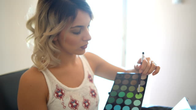 beautiful young woman vlogging about cosmetics - eyeshadow stock videos & royalty-free footage