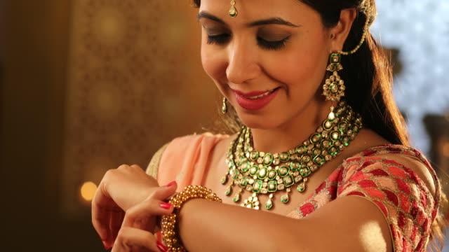 CU PAN Beautiful young woman wearing a cuff bracelet during Diwali festival / New Delhi, Delhi, India