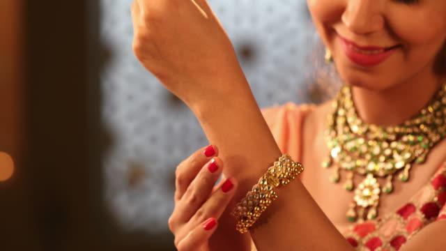 CU Beautiful young woman wearing a cuff bracelet during Diwali festival / New Delhi, Delhi, India