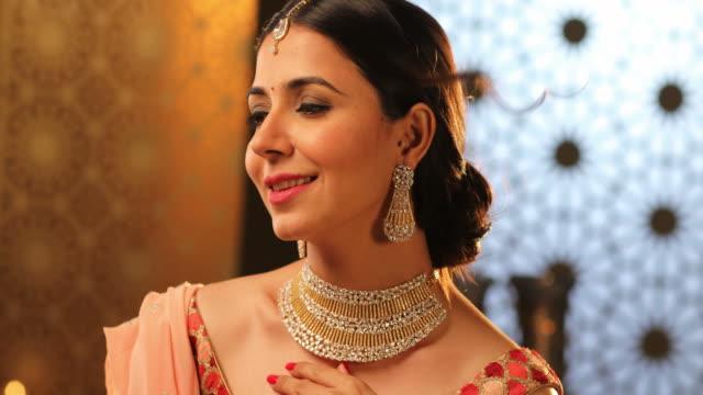 CU Beautiful young woman wearing diamond jewellery during Diwali festival / New Delhi, Delhi, India