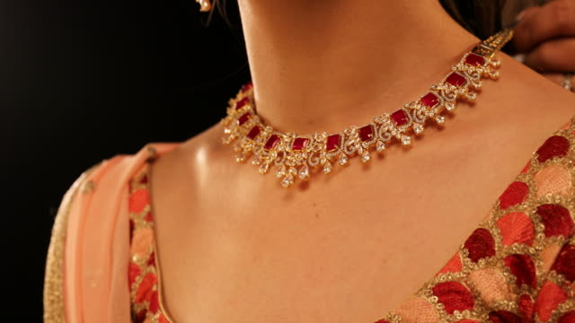CU TU Beautiful young woman wearing diamond necklace and earrings during Diwali festival / New Delhi, Delhi, India