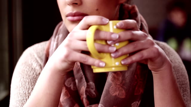 beautiful young woman with coffee - yellow stock videos & royalty-free footage