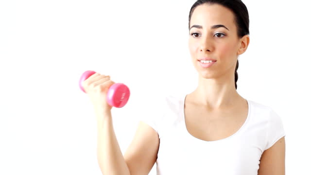 Beautiful young woman with dumbbells.