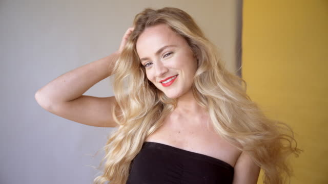 a beautiful young woman with long blond hair. with clear sharp skin and movie star make-up. - tubtopp bildbanksvideor och videomaterial från bakom kulisserna