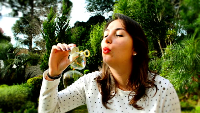 beautiful young woman with white dress blowing bubbles - white dress stock videos & royalty-free footage