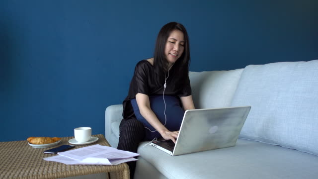 beautiful young woman working with laptop at living room at home - only young women stock videos & royalty-free footage