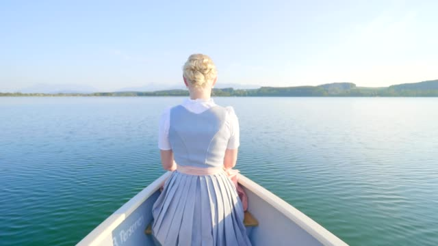 beautiful young women on boat on lake at sunset - bavaria stock videos & royalty-free footage