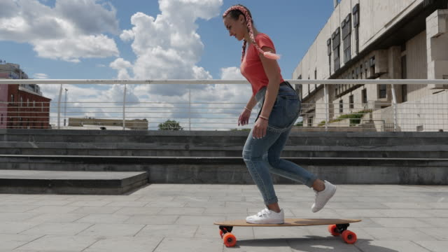 beautiful youth riding skateboard outdoors - dungarees stock videos and b-roll footage