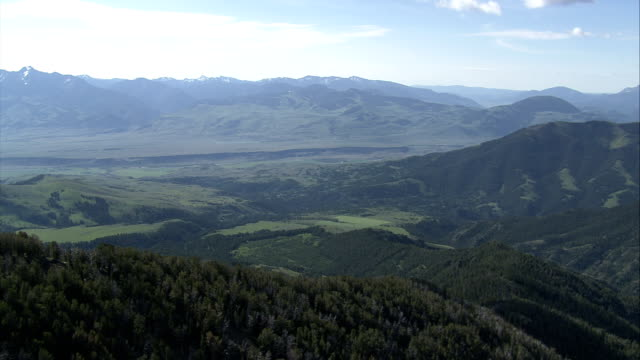 Beautifully wooded mountains encompass deep valleys in Yellowstone National Park. Available in HD.
