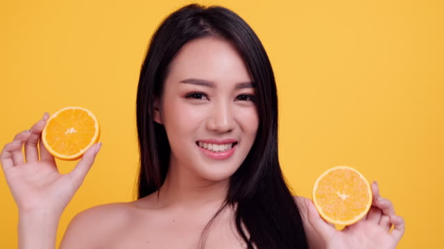 beauty asia woman with orange fruit - ascorbic acid stock videos & royalty-free footage