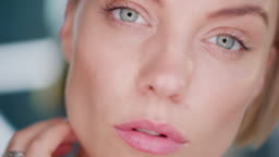 Beauty blogger looks on herself through mirror, self love