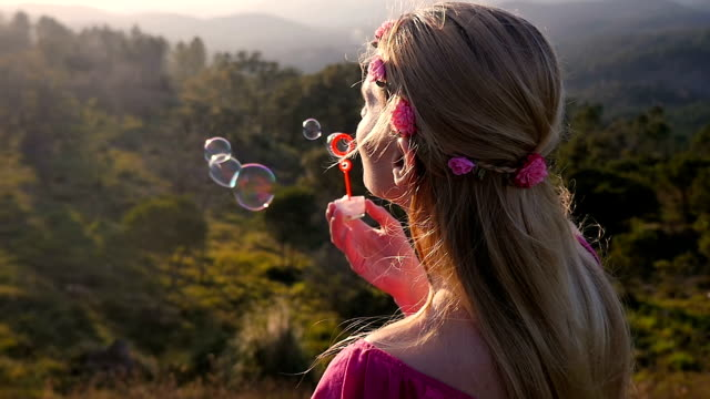 beauty blowing bubbles - headband stock videos & royalty-free footage