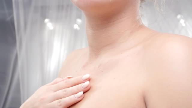 Beauty Care. Young Beautiful Girl Applying Moisturizer