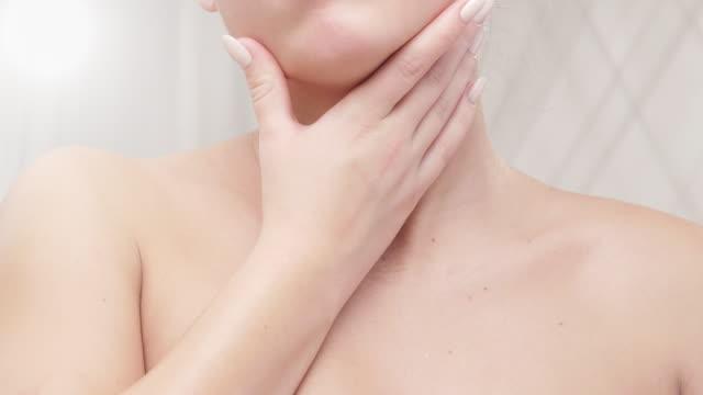 Beauty Care. Young Beautiful Woman Applying Moisturizer