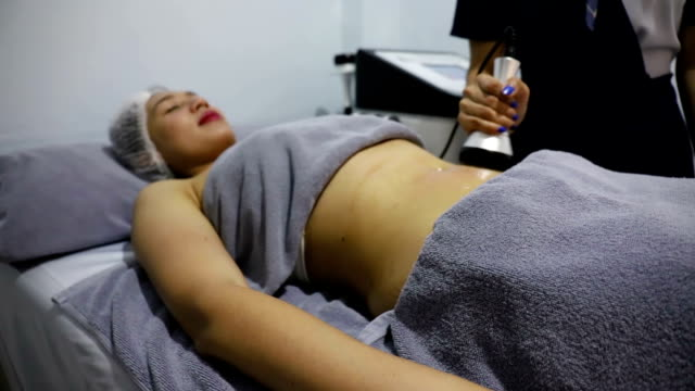 beauty clinic.young woman getting fat removing. - cellulite stock videos & royalty-free footage