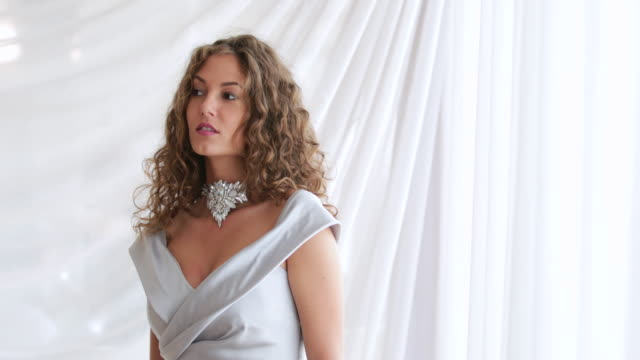 beauty contest model in sleeveless gray dress and necklace - necklace stock videos & royalty-free footage
