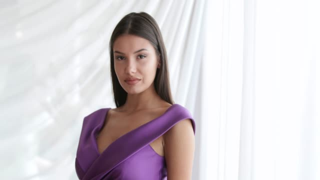 beauty contest model posing in sleeveless purple dress - beauty contest stock videos & royalty-free footage