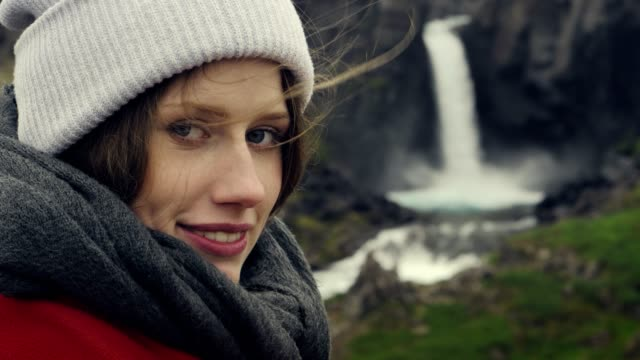 beauty in nature. traveler admiring waterfall. smiling to camera - admiration stock videos & royalty-free footage