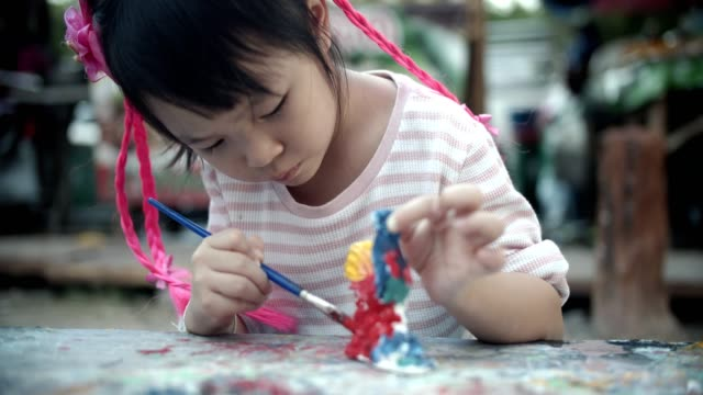 Beauty little girl(4-5 years) enjoying to paint
