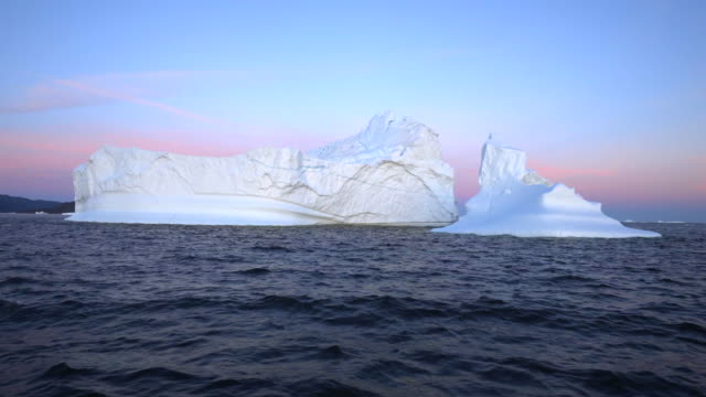 beauty of icebergs at disko bay during sunset - inlet stock videos & royalty-free footage