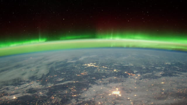 beauty of planet earth from the international space station (iss). colorful aurora borealis seen from space - utforskning bildbanksvideor och videomaterial från bakom kulisserna