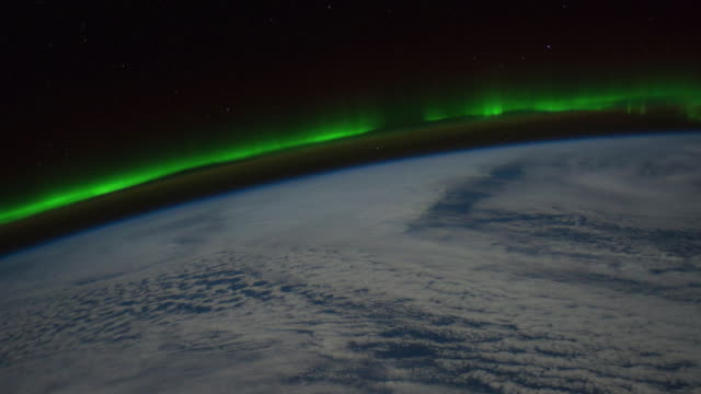 beauty of planet earth from the international space station (iss). colorful aurora borealis seen from space - オーロラ点の映像素材/bロール