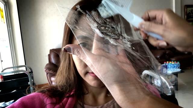 Beauty saloon. Barbershop. The stylist paints his client's hair.